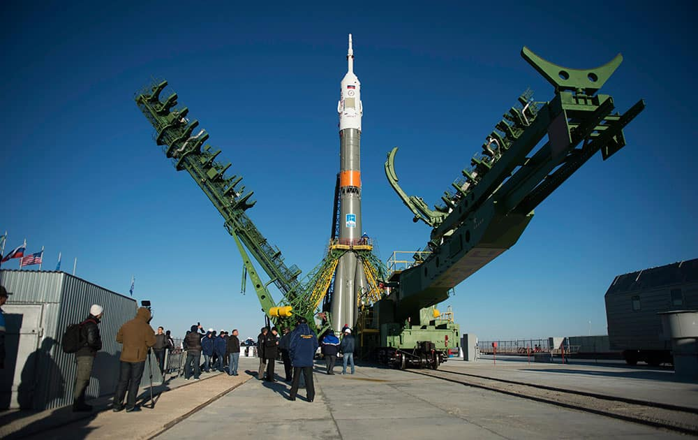 The gantry arms are raised around the Soyuz MS-02 spacecraft after it was raised into a vertical position on the launch pad