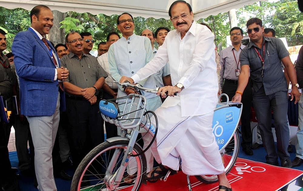 Venkaiah Naidu rides a cycle
