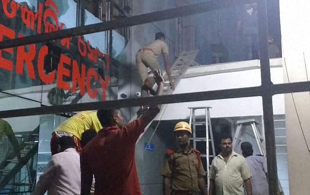Rescue work underway at the Institute of Medical Sciences and Sum Hospital in Bhubaneshwar where a fire broke out