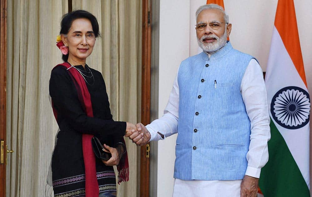 PM Narendra Modi shakes hands with Myanmar State Counsellor and Foreign Minister Aung San Suu Kyi