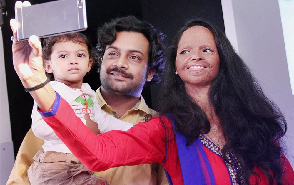 Acid attack victim Laxmi clicks a selfie with her husband and child at Diversity Awareness Month organised by Erricson in Gurgaon