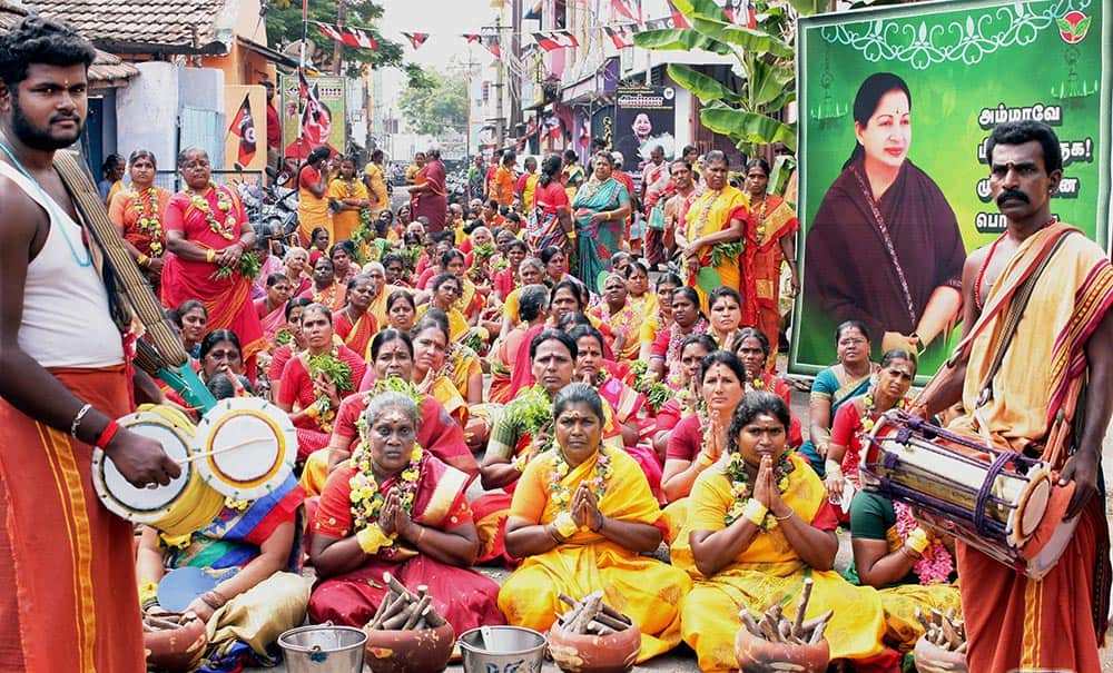AIDMK members special offering prayers for the speedy recovery of their Leader J Jayalalithaa
