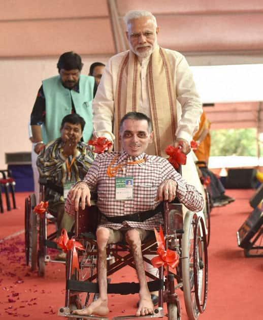 Narendra Modi distributes aids and equipment