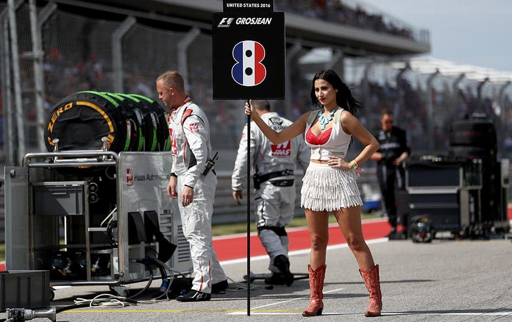 The grid girl for Romain Grosjean of France and Haas F1