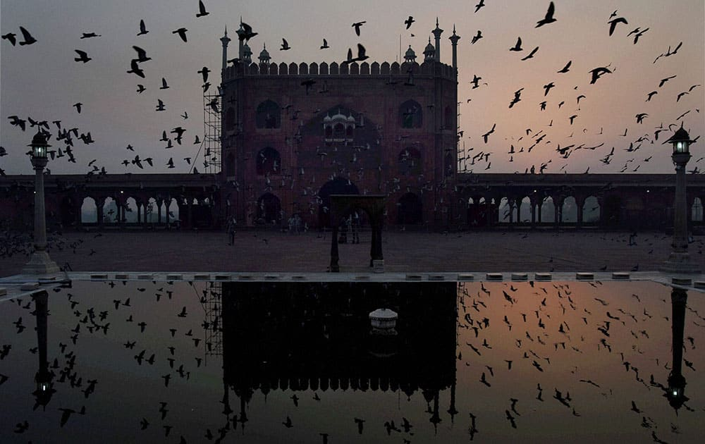 Jama Masjid is reflected in the pond
