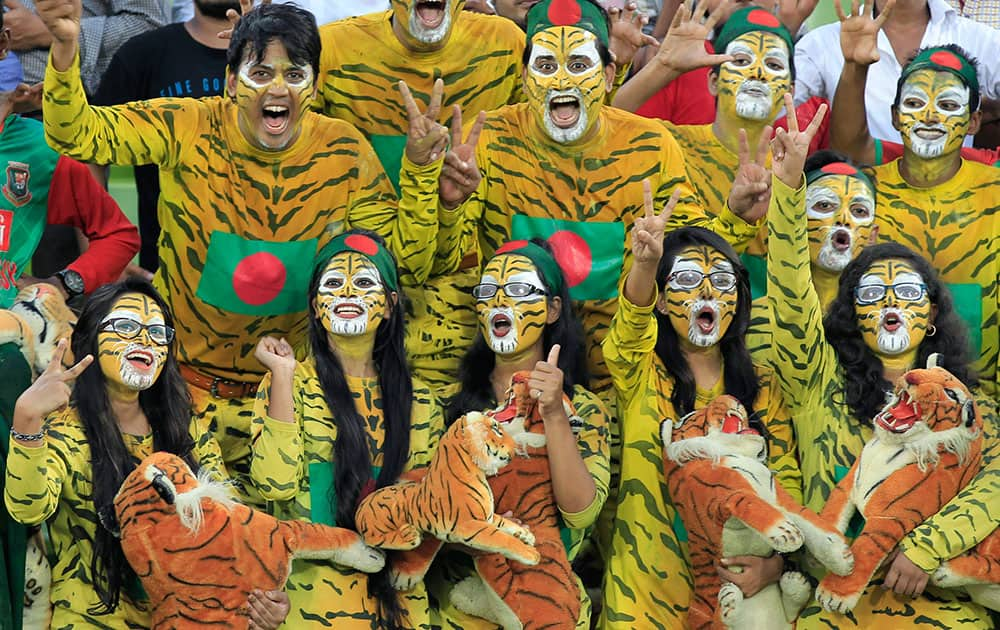 Bangladeshi spectators celebrate their victory over England in the second cricket test match in Dhaka, Bangladesh