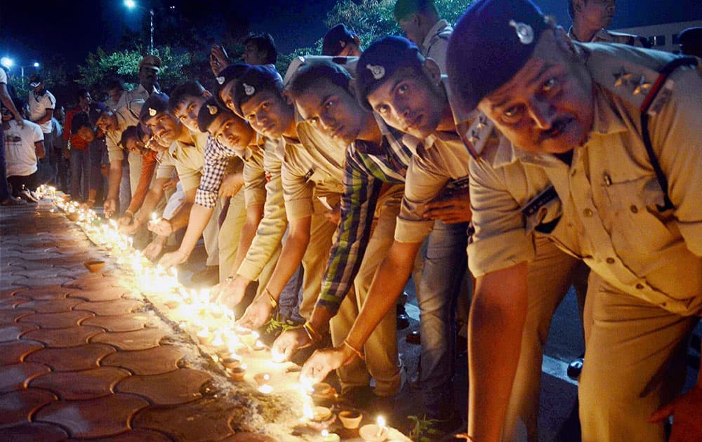 Police personnel lighting lamps in a campaign Ek Diya Shaheedon Ke Naam during a program on the eve of Diwali festival in Bhopal
