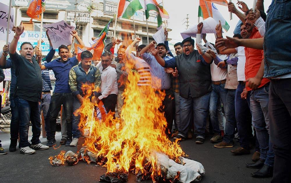 Activists of Bharatiya Janata Yuva Morcha (BJYM) burn an effigy representing Pakistan