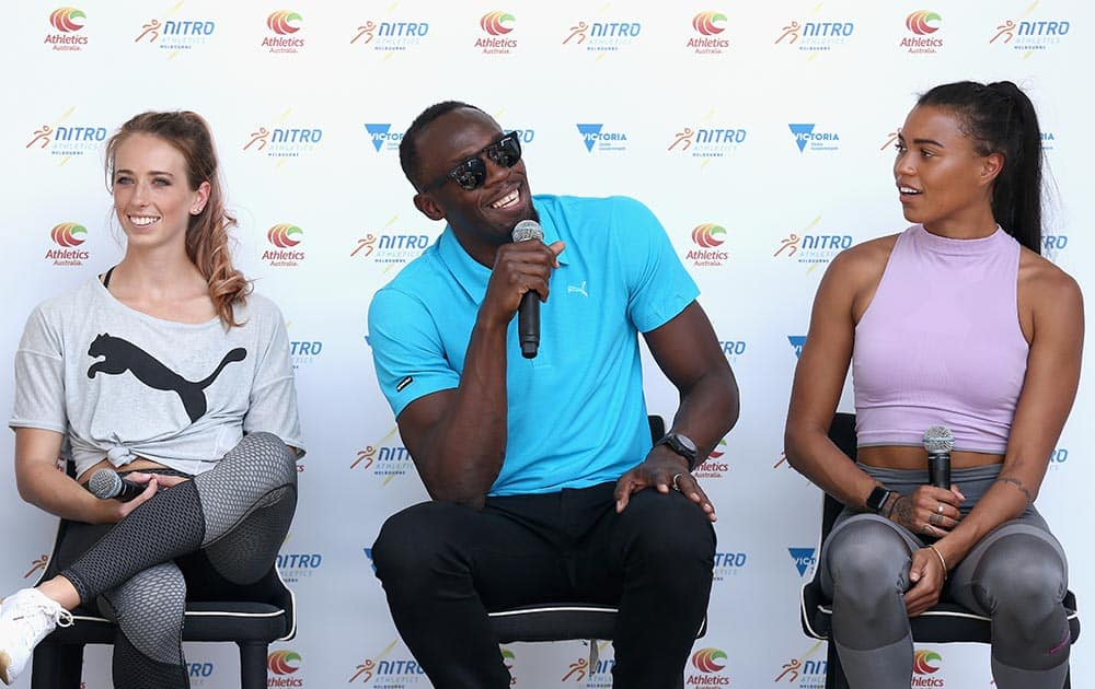 Usain Bolt along with Australian Olympians Anneliese Rubie and Morgan Mitchell