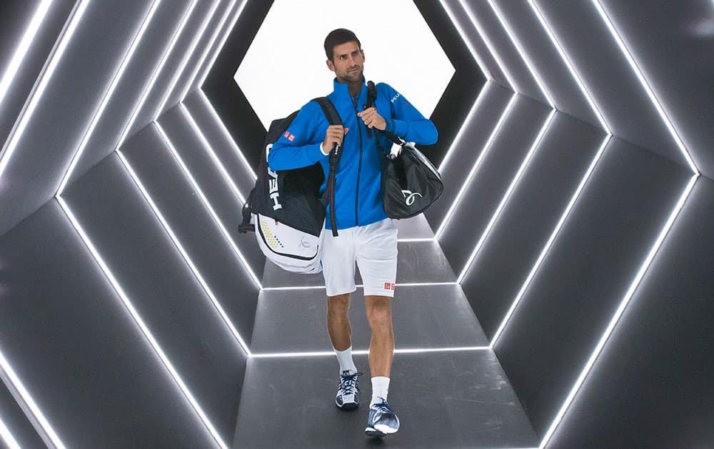Novak Djokovic of Serbia arrives to play Marin Cilic of Croatia