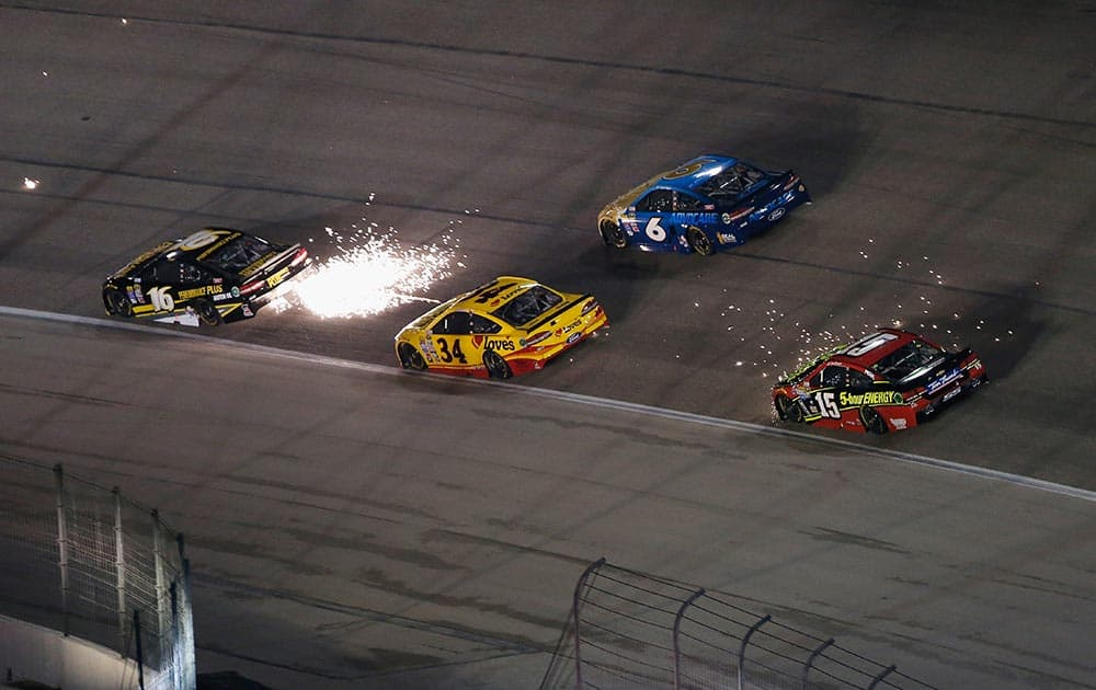 Sparks are seen as Greg Biffle, driver of the #16 Performance Plus Motor Oil Ford