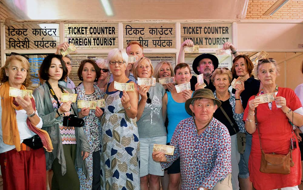 A group of foreign tourists upset over the refusal of Rs 500 and Rs 1000 notes at the ticket window of Taj Mahal in Agra