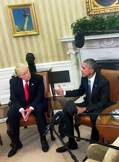 President Barack Obama shakes hands with President-elect Donald Trump in the Oval Office of the White House in Washington