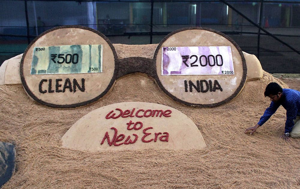 Sand art on new currency notes