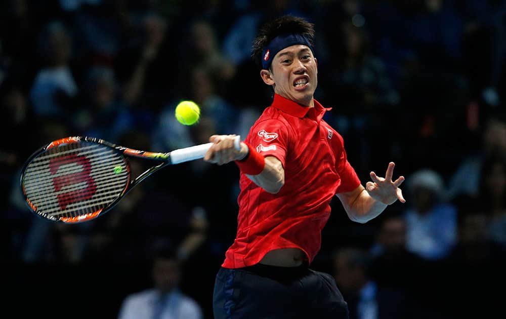Kei Nishikori of Japan plays a return to Britains Andy Murray during the ATP World Tour