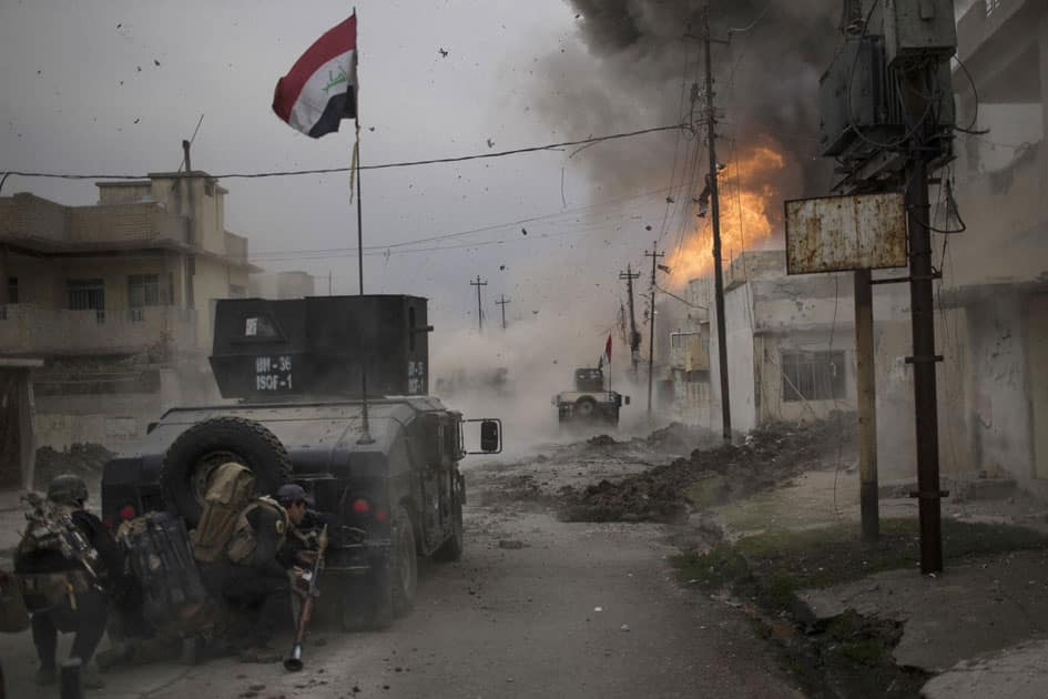 A car bomb explodes next to Iraqi special forces