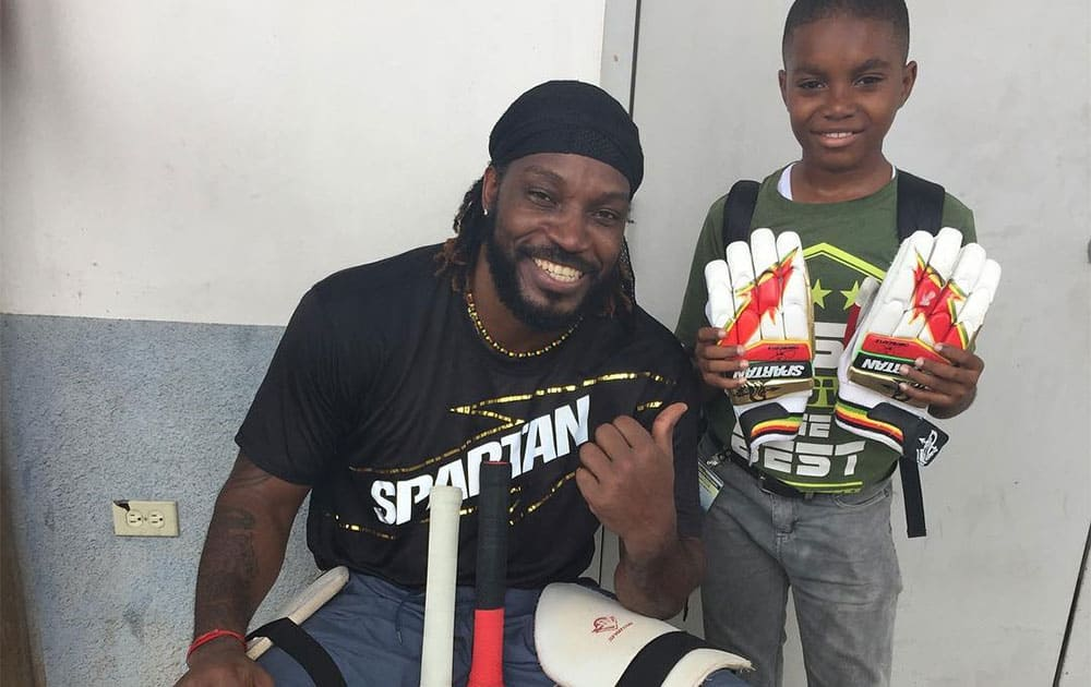 Chris Gayle :- Lucky youngster to get my gloves
