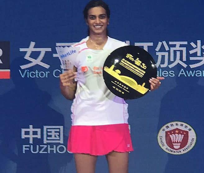 PV Sindhu poses with trophy