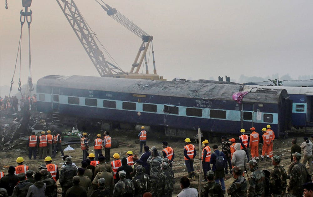 Rescuers work in progress at the site of accident where Patna-Indore Express train derailed