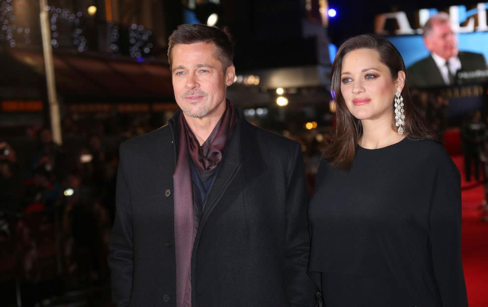 Actors Brad Pitt and Marion Cotillard pose for photographers upon arrival at the premiere of the film Allied in London