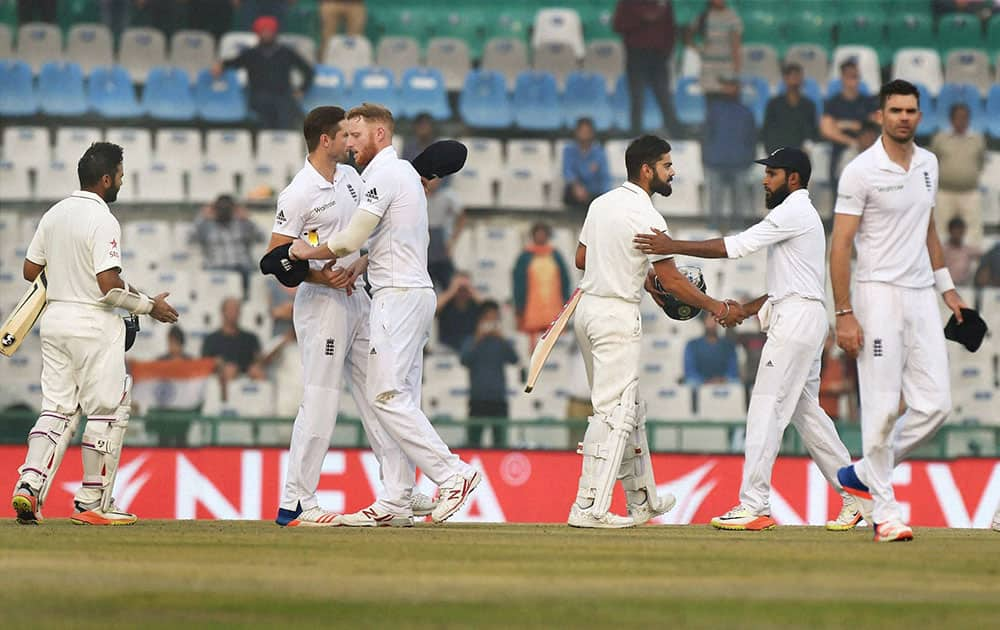 Players of India and England greet each other after India won the third Test match between India and England in Mohali