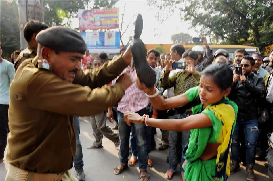 Woman beats Police man