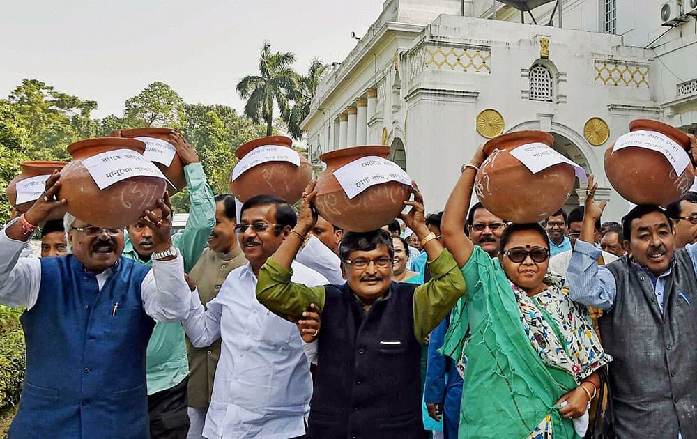 TMC MLAs carry earthen pots on their heads and shouting slogans against Prime Minister Narendra Modi