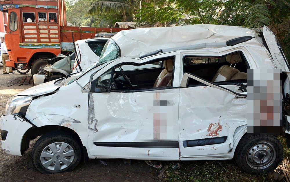 A heavily damaged car after it was involved in an accident killing a woman on the Pune-Bengalore highway in Karad