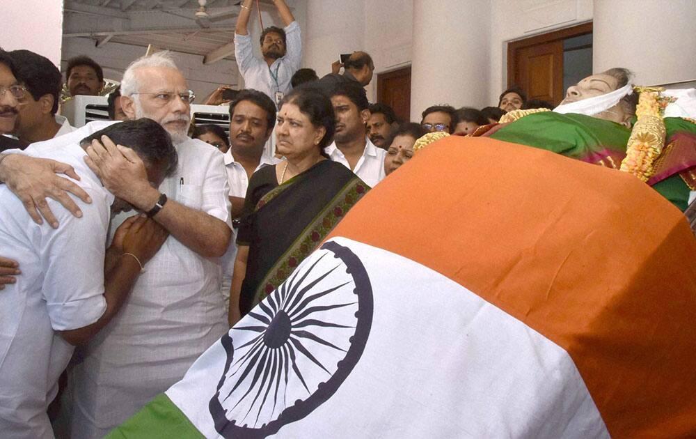 Prime Minister Narendra Modi consoles O Panneerselvam