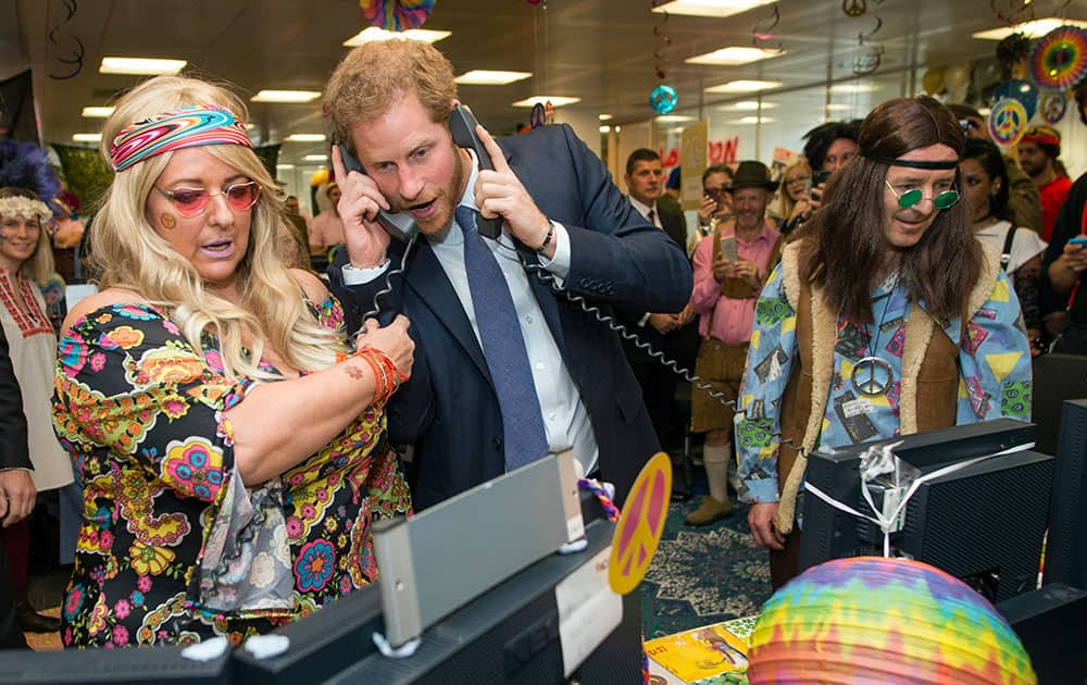 Prince Harry talks on the phone, during an ICAP Charity Trading Day