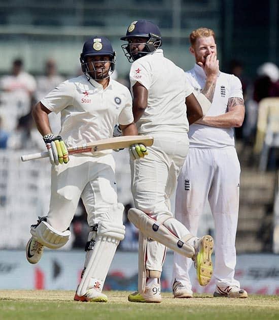 Karun Nair and R Ashwin take runs between the wicket