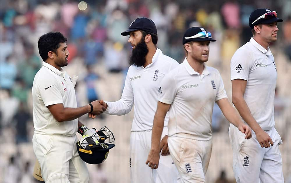 Karun Nair being congratulated by England players