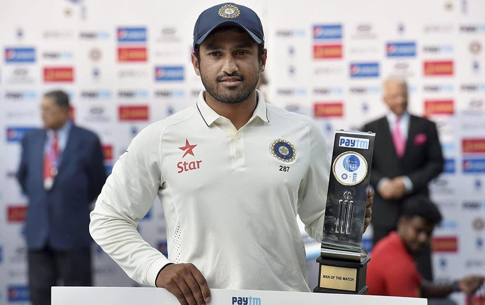 Karun Nair poses with man of the match trophy after winning the test series at MAC Stadium in Chennai