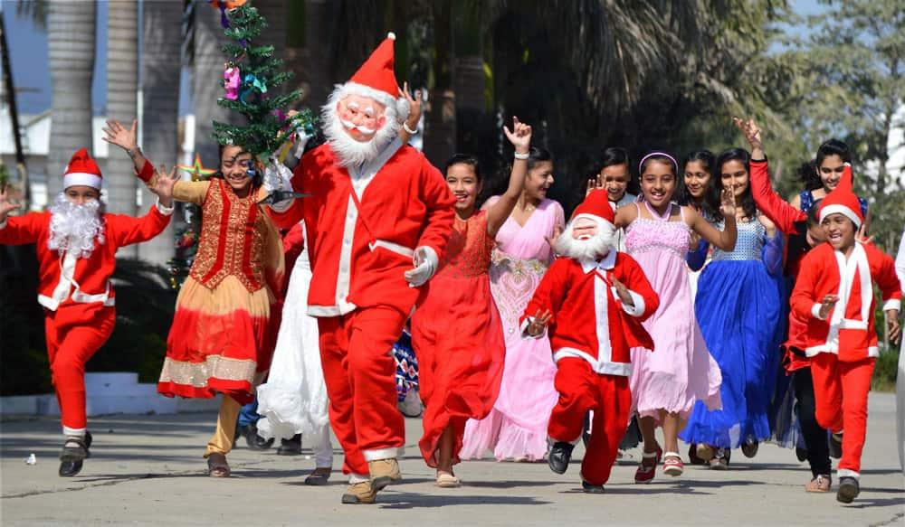 Children enjoying with a Santa Claus
