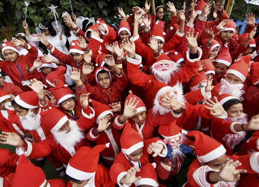 School children dress up as Santa Clau
