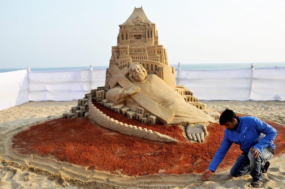 Sand artist Manas Sahoo creates a sand sculpture