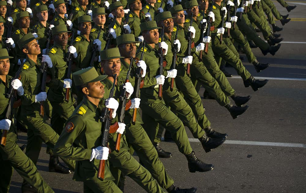 Soldiers march through Revolution Square in honor of late Cuban leader Fidel Castro