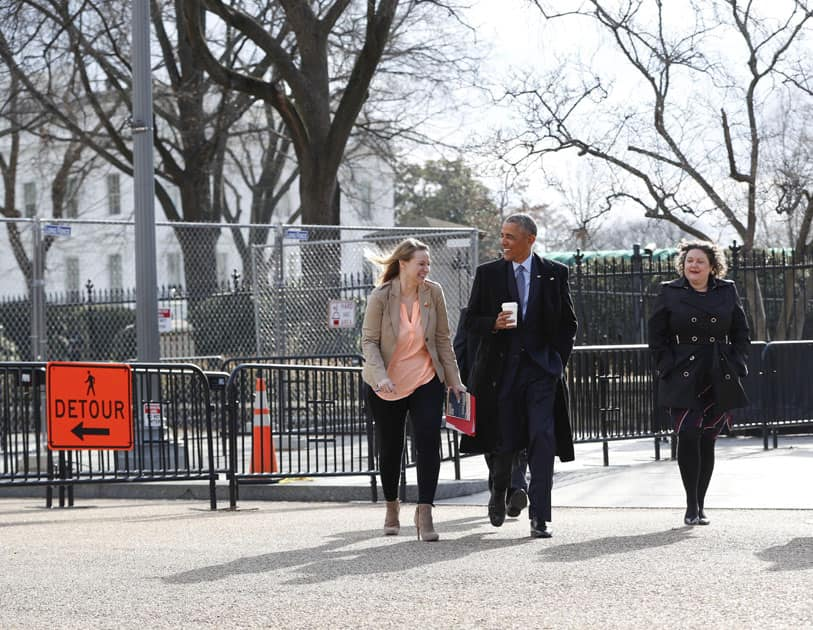 President Barack Obama walks out of the White House