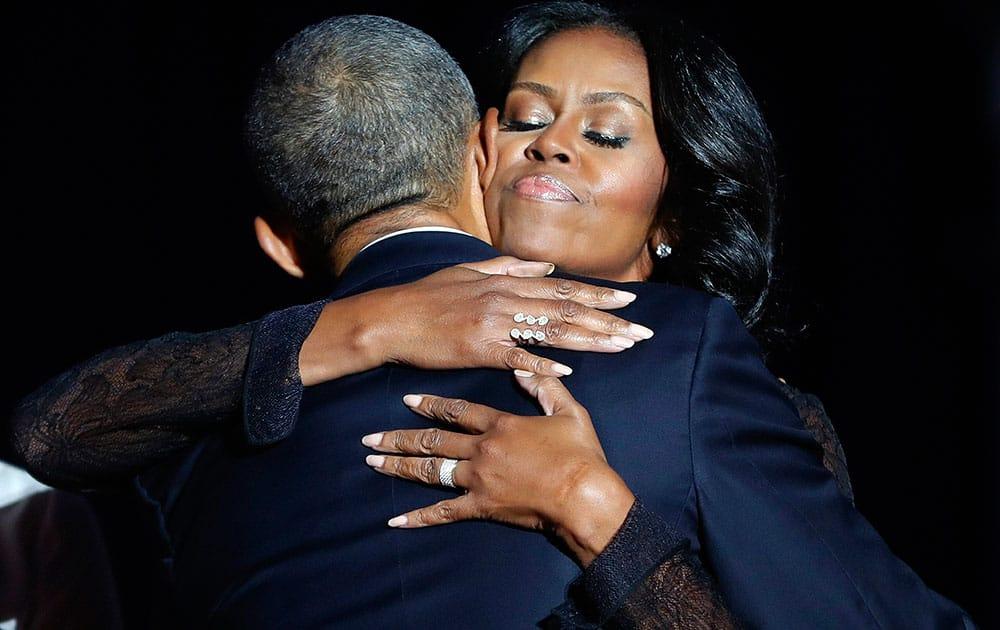 Michelle Obama hugs Barack Obama