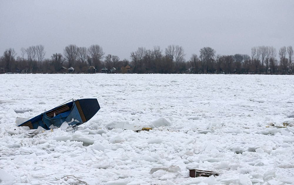A boat is trapped in the frozen Danube river