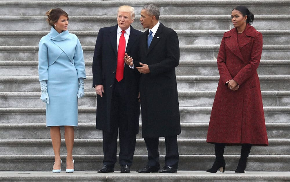 President Donald Trump and former president Barack Obama stand on the steps of the Capitol in Washington