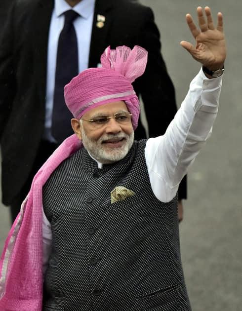 Prime Minister Narendra Modi waves to the crowd