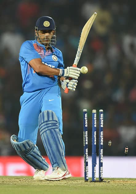 M S Dhoni being clean bowled during the T20 match
