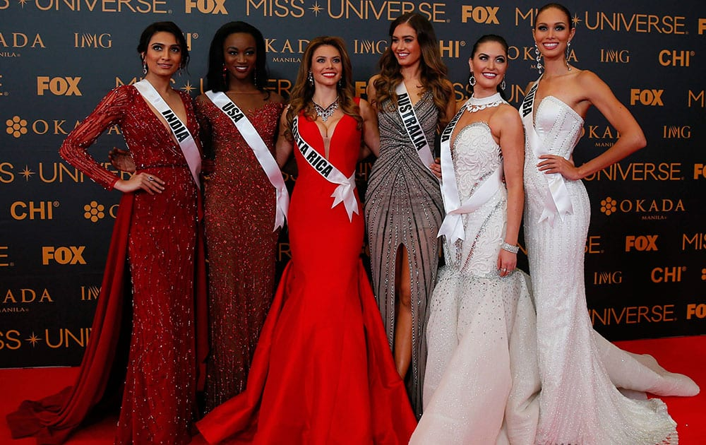 Miss Universe contestants pose on the red carpet