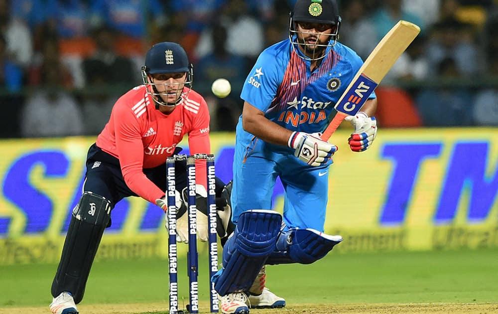 Suresh Raina plays a shot during the 3rd T20 match between India and England at Chinnaswamy Stadium in Bengaluru