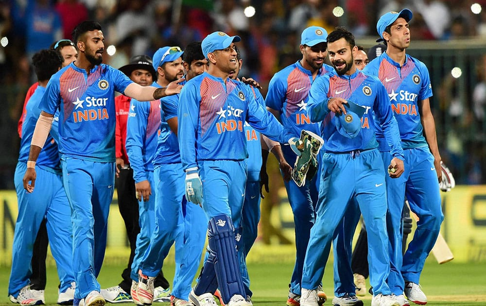 Virat Kohli with team mates celebrate the win over England during the 3rd T20 between India and England