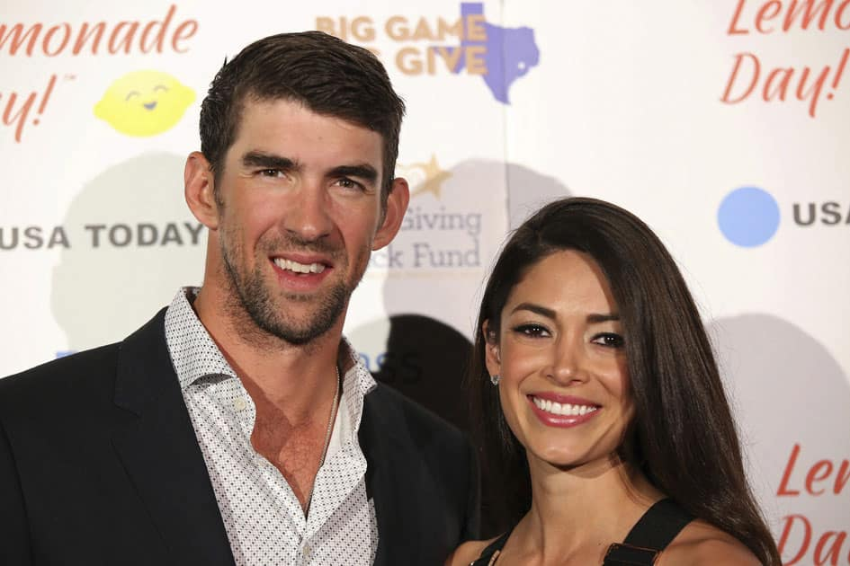 Michael Phelps and wife Nicole Johnson pose for a photograph