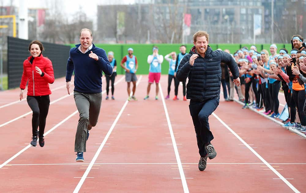 Britains Prince William, Kate, and Prince Harry take part in a relay