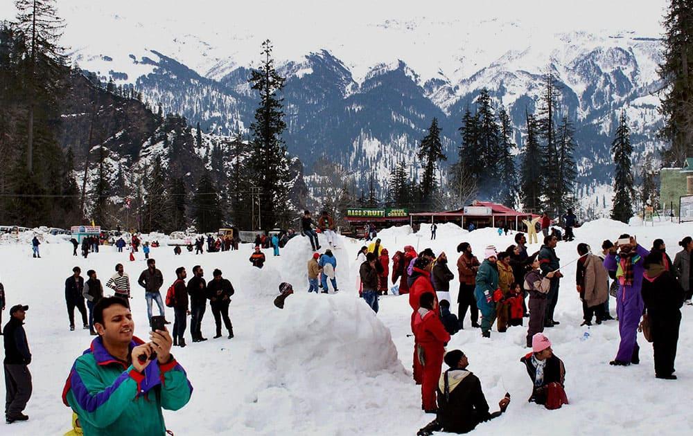 Tourists enjoy fresh snow at Solang Nala in Manali