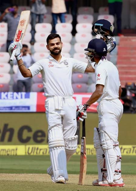 Virat Kohli celebrates his 200